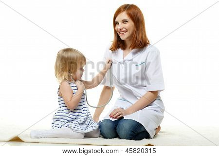 Female  Doctor And Small Patient. Pediatrics. .