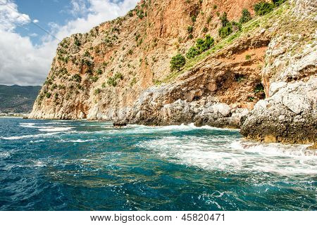 Rock And Mediterranean Sea In Turkey