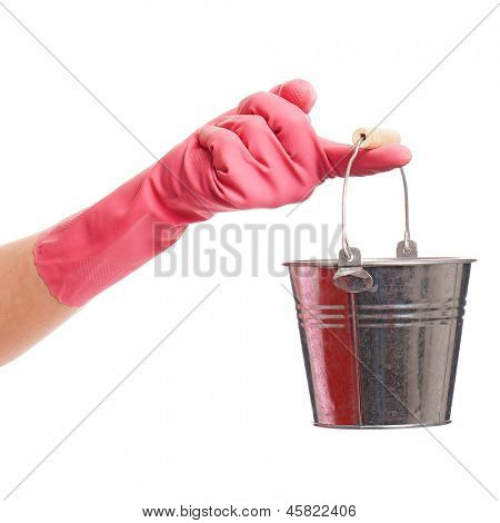 Hand in a pink domestic glove holding silver pail isolated over white background