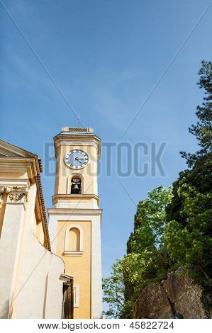 Yellow Clock Tower In Eze