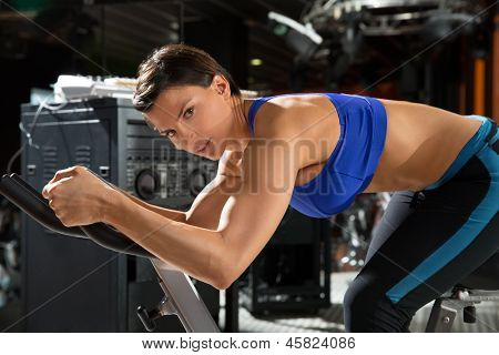 Aerobics spinning monitor trainer woman at gym at trainning class