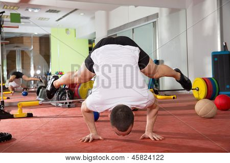 Crossfit fitness handstand push ups balance man workout at gym