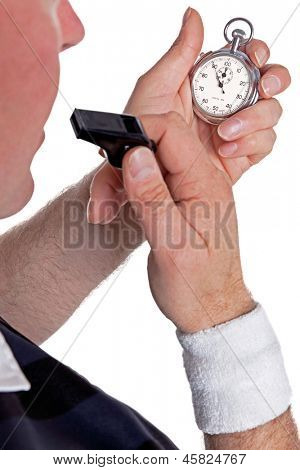 A referee checking his stopwatch and about to blow the whistle, isolated on a white background.