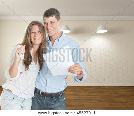 Happy young couple moving in a new home