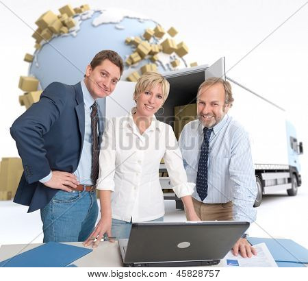Work team around a computer in an international transportation context