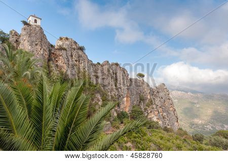 Low angle view of a mountain peak with a church bell tower