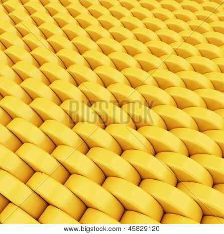 Abstract Golden Background Made Of Shining Plastic Cylinder