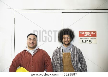 Two men standing in front of restricted area
