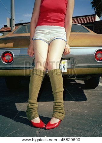 Young woman in leg warmers