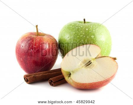Isolated wet green and red apple with sliced half