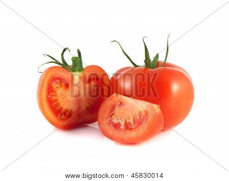 Isolated red tomato with sliced half on a white
