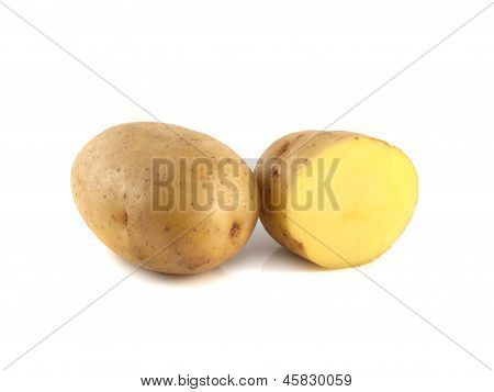 New potato with sliced half isolated on white