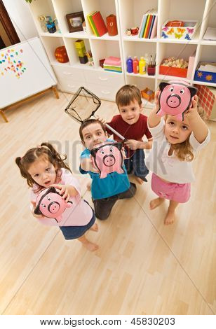 Children Playing With Piggybanks