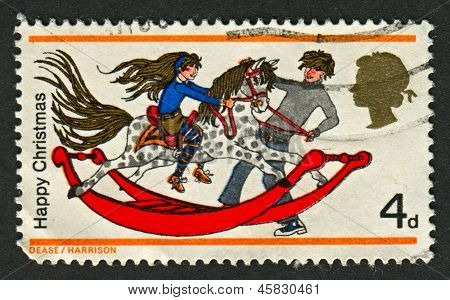 UK - CIRCA 1968: A stamp printed in UK shows image of the Girl and Boy with Rocking Horse , circa 1968.