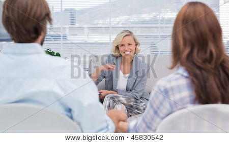 Psychologist speaking to a couple during a session