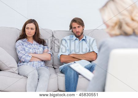 Young couple going through therapy and listening to the therapist