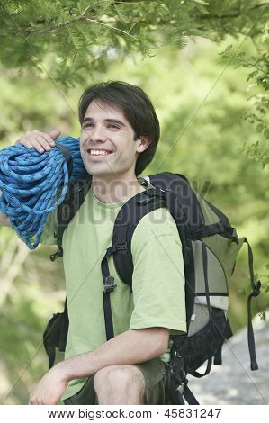 Man holding a bundle of climbing rope