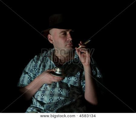 Macho With Cup And Cigar