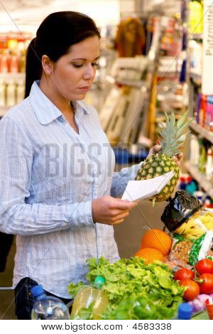 Shopping At The Supermarket With A Shopping List