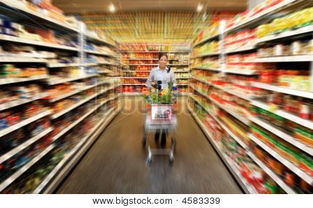 Woman Food Shopping At The Supermarket