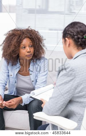 Therapist taking notes when patient is speaking