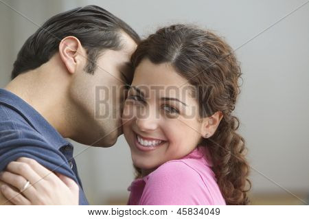 Boyfriend kissing girlfriend on the cheek