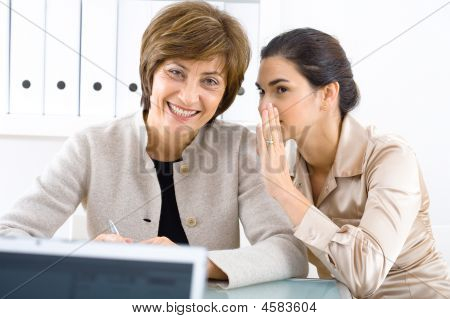 Whispering Businesswomen