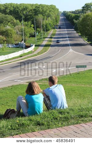 Pair Young Enamoured People Near The Road