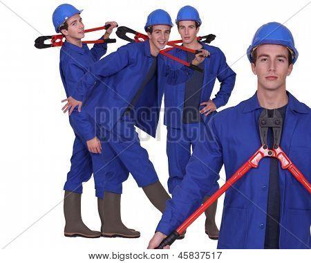 Man stood holding bolt-cutters