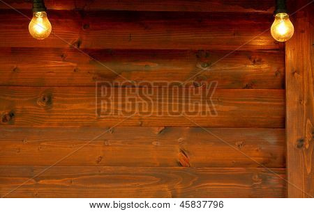 Old Wooden Board With Two Bulbs As Background