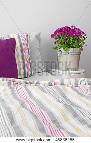 Bedroom Decorated With Purple Flowers