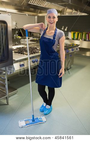 Surprising woman cleaning the kitchen floor