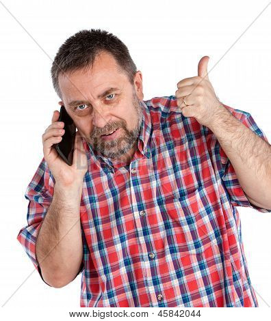 Middle-aged Man Speaks On A Mobile Phone