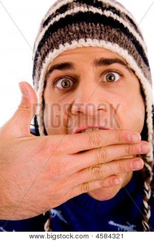 Portrait Of Shocked Man Wearing Woollen Cap