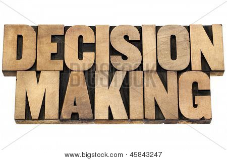 decision making - isolated text in letterpress wood type printing blocks