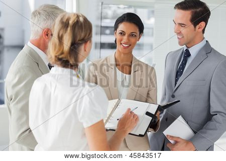 Smiling business people making an appointment in the workplace