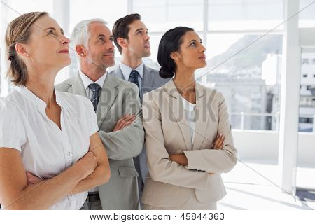 Business people looking at the same way in the workplace