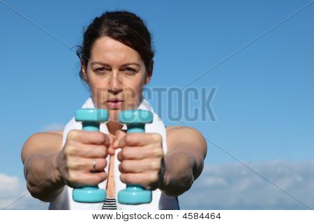 Healthy Fit Woman Working Out With Weights