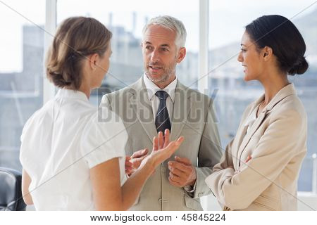 Group of business people discussing together in their office