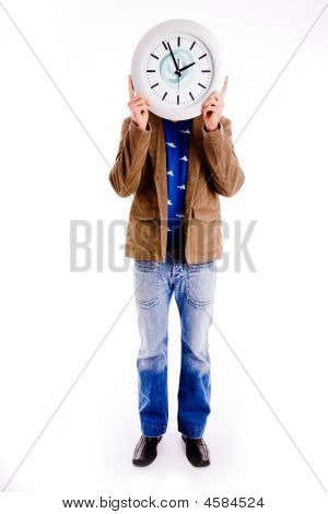 Front View Of Man Hiding His Face With Watch