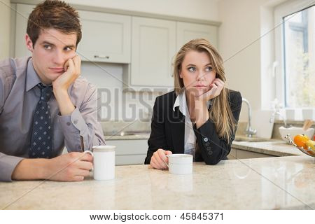 Woman and man having a dispute in kitchen