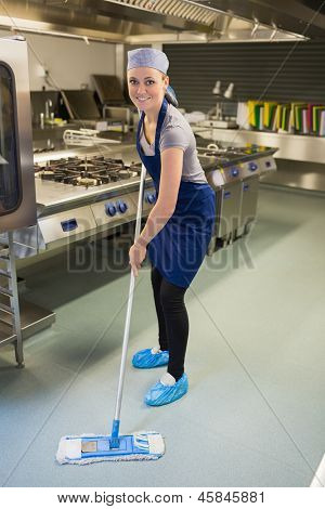 Woman cleaning the kitchen in the restaurant
