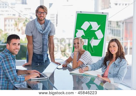 Team having meeting about recycling in bright office