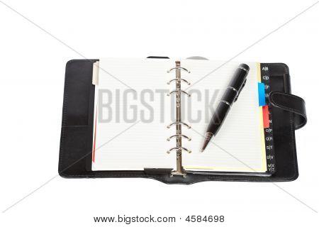 Opened Agenda With Pen