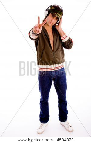 Full Body Of Man Wearing Headphone And Showing Peace Sign