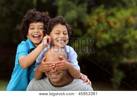 Mixed race father and sons