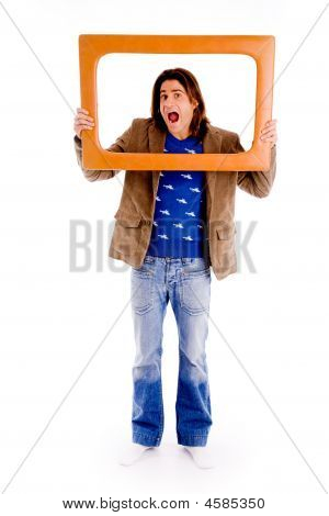 Front View Of Man Looking Through Frame