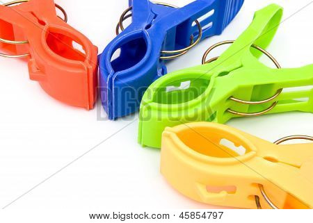 Colorful Clothespins On White With Copy Space