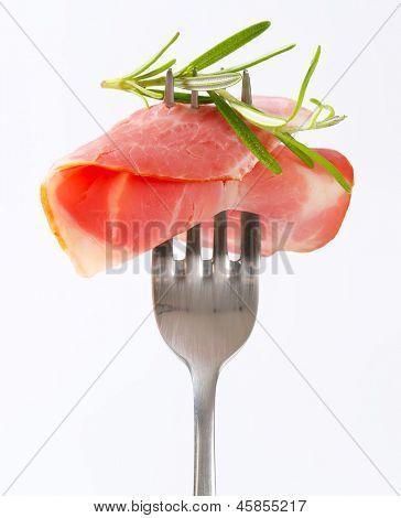 detail of sliced ham on a fork