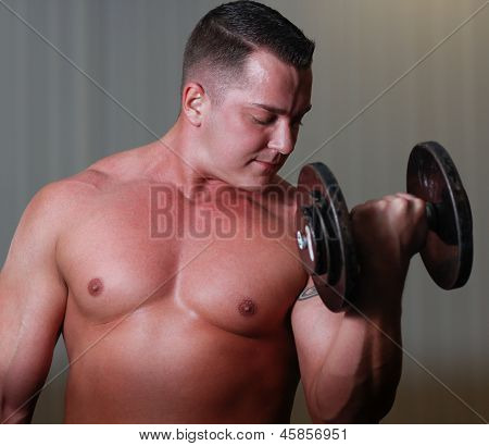 Powerlifter With Dumbels In Gym